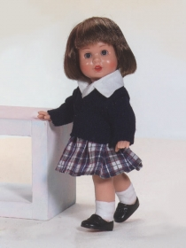 Mini Mariquita in school uniform with kilt