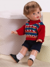 Mini Juanín with navy shorts and red sweater